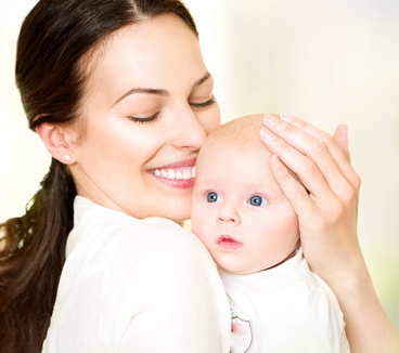 Happy mother and her newborn baby. Maternity concept